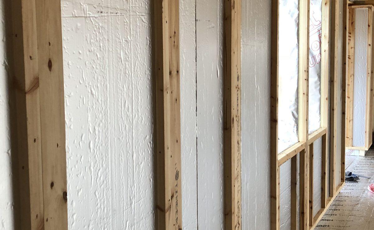 Erecting closed panel timber frame